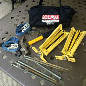 My tie down bag: The Claw tie downs, ratchet straps, safety glasses (a must when hammering metal), and a good hammer