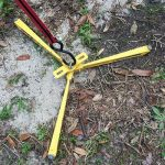 The Claw tie down for awning support poles