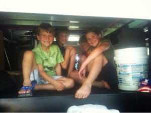4 Kids Playing in Storage Hatch
