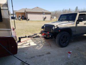 Jeep Wrangler behind Dynamax Motorhome