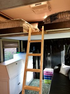 Beds Up a Ladder on a Lift in a toy hauler