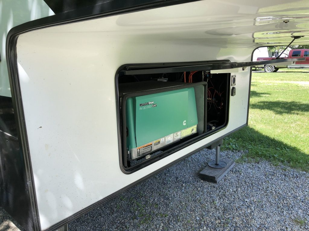 Onan 5500 generator in front compartment of fifth wheel