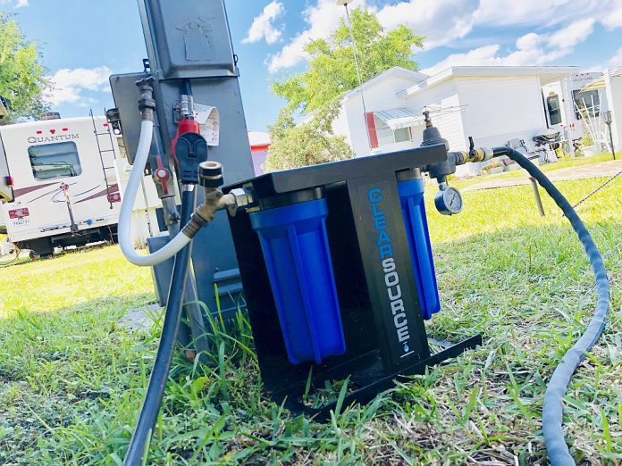 Clearsource RV Water Filter hooked up at an RV campsite