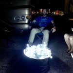 Pretend campfire of Christmas lights on a propane firepit