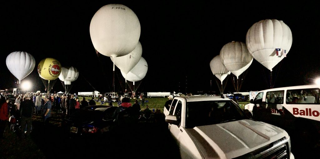 3 rows of gas balloons being inflated