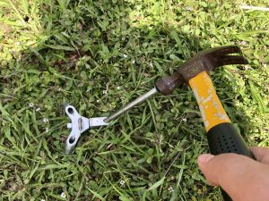Hammering a nail into a Smart Anchor tie down